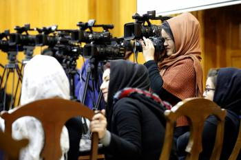 MANUA//Fardin Waezi Des journalistes lors d'un /u00e9v/u00e9nement /u00e0 Kaboul, /u00e0 l'occasion de la Journ/u00e9e nationale des journalistes afghans (mars 2019), en faveur de la libert/u00e9 des m/u00e9dias et de la solidarit/u00e9 avec les journalistes en Afghanistan.